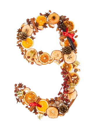 flavorings: Christmas number made of dry spices and gifts
