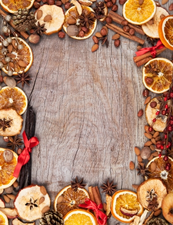 anise: Christmas spices with dry orange and apple slices in frame with free space for text Stock Photo