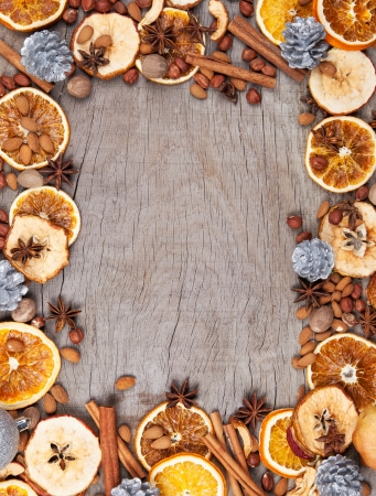 badian: Christmas spices with dry orange and apple slices in frame with free space for text Stock Photo