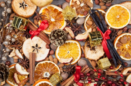 Christmas spices with dry orange and apple slices photo