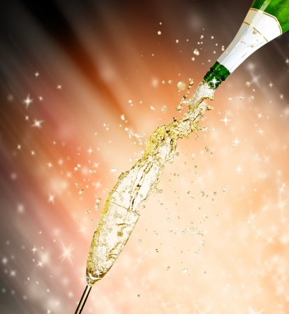 Celebration theme with splashing champagne photo