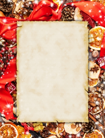 apple christmas: Christmas spices with dry orange and apple slices in frame with blank old paper
