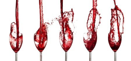 cheers: Collection of red wine glasses splashing out