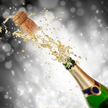 Celebration theme with splashing champagne Stock Photo - 16213297