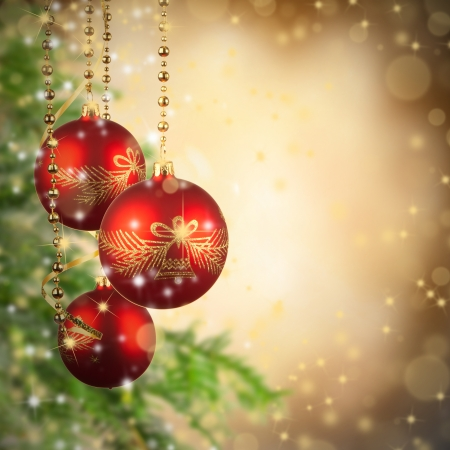 Christmas theme with red glass balls and free space for text photo