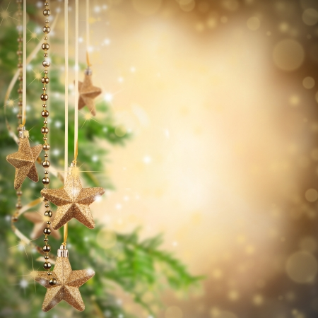 group of christmas baubles: Christmas theme with golden glass stars and free space for text
