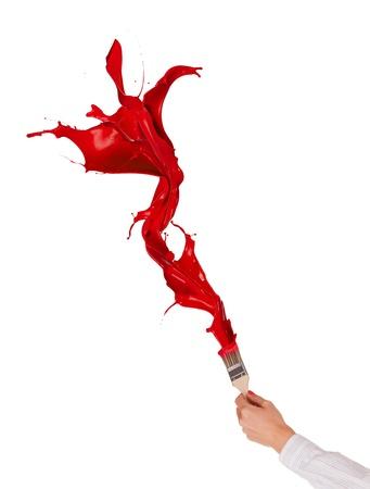 paint brush:  Red paints splashing out of brush. Isolated on white background  Stock Photo
