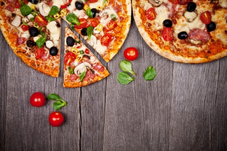 16595089: Delicious italian pizzas served on wooden table