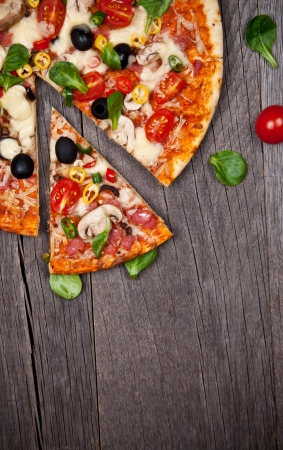 Delicious italian pizza served on wooden table Stock Photo - 16595087