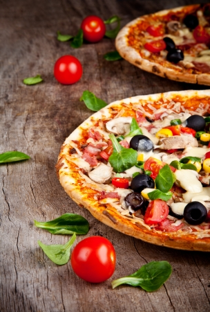 served: Delicious italian pizza served on wooden table