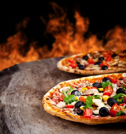 italian salami: Delicious italian pizza served on wooden table
