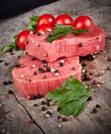 Raw beef steaks prepared for grill photo