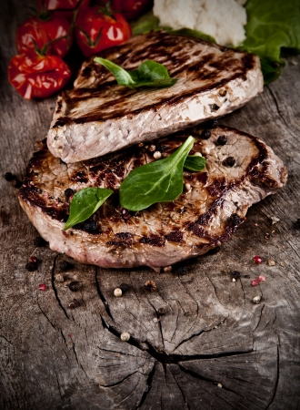 charbroiled: Delicious beef steaks on wood