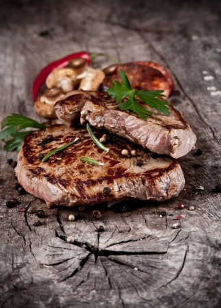 mignon: Delicious beef steaks on wood