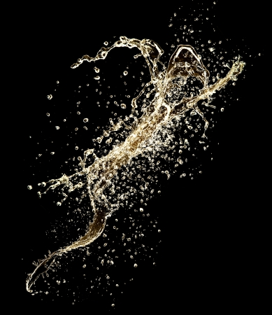 Champagne splash isolated on black background photo