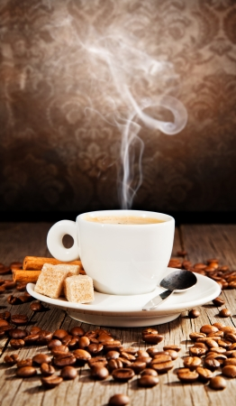 steaming coffee: Coffee still life in grunge design Stock Photo