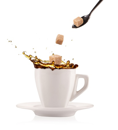 sugar cube: Coffee splashing out of cup with flying sugar cubes, isolated on white background