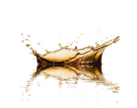 Brown liquid splash of coffee or cola, isolated on white background photo