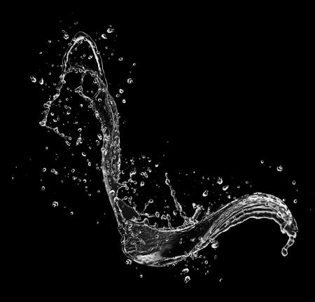 water beautiful:  Water splash isolated on black background