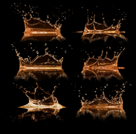 Liquid splashes collection, isolated on black background photo