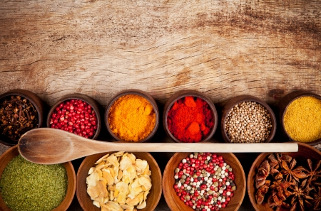 curry spices: Various kind of spices in wooden bowls