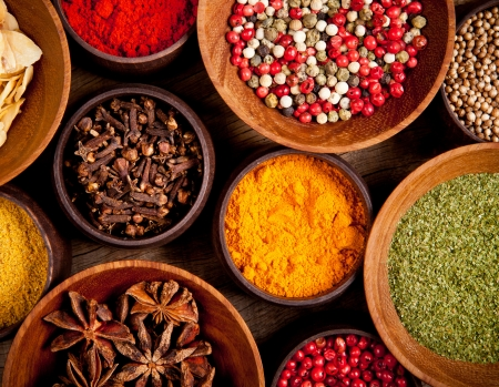 Various kind of spices in wooden bowls Stock Photo - 17182208