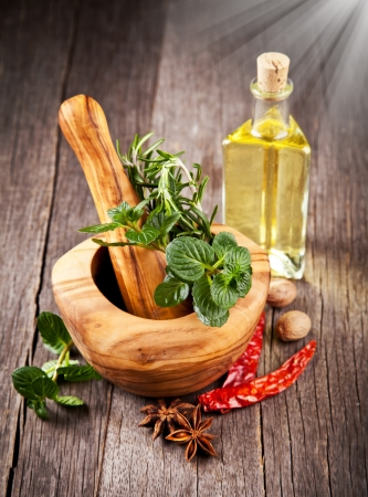 pepper grinder: Wooden grinder with spices Stock Photo