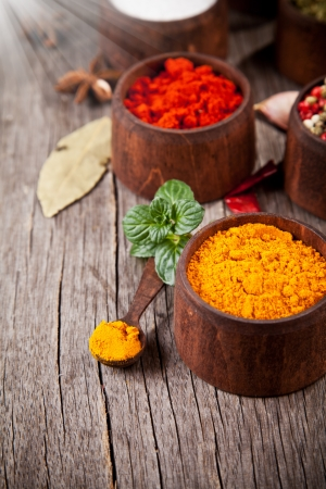 Various kind of spices in wooden bowls Stock Photo - 17182182