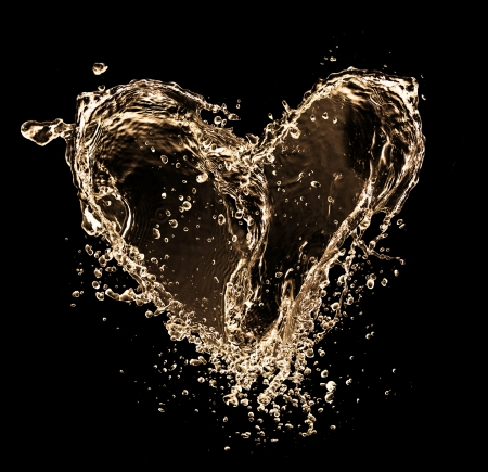 Heart symbol made of liquid splashes, isolated on balck background photo