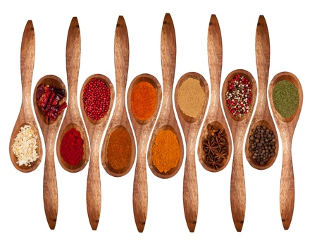 black pepper: Concept with spices on wooden spoons, isolated on white background