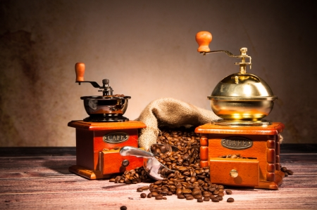 Coffee still life with wooden grinders photo