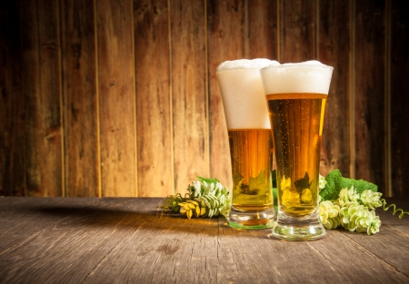 lager: Glass of beers on wooden table