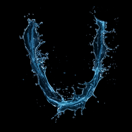 Water splashes letter U isolated on black background  photo