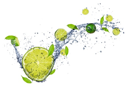 Fresh limes in water splash, isolated on white background  photo