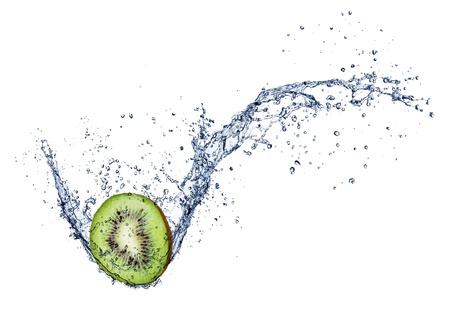 Kiwi in water splash, isolated on white background