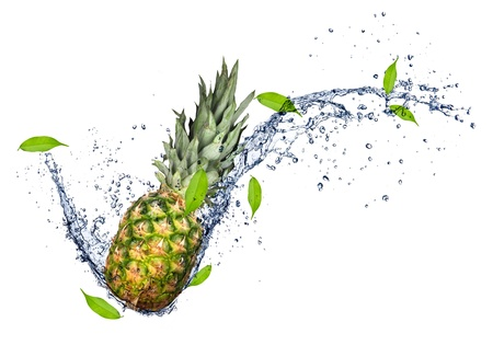 Pineapple in water splash, isolated on white background  photo