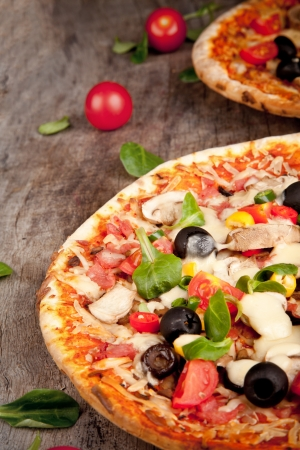 Delicious italian pizza served on wooden table photo