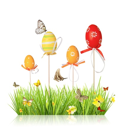 Easter colored eggs in grass, isolated on white background Stock Photo - 17591742