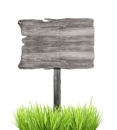 Wooden empty sign in grass, isolated on white background Stock Photo - 17695416