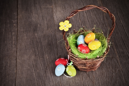 Easter basket on wooden table photo