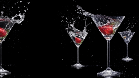Martini drinks with splashes, isolated on black background photo