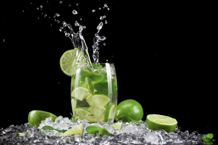 Mojito drink wish splash, isolated on black background Stock Photo - 17901111