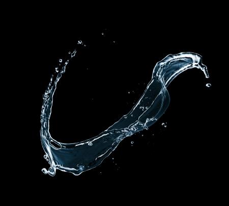 Water splash isolated on black background Stock Photo