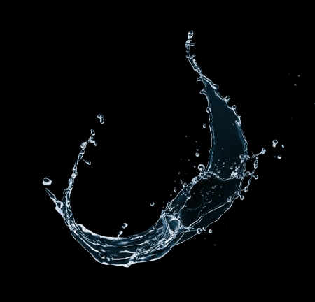 Water splash isolated on black background photo