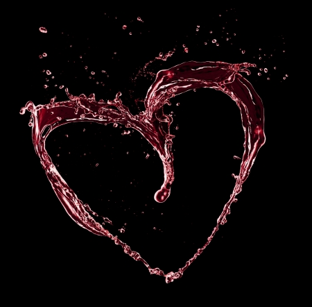 Heart symbol made of water splashes, isolated on black background photo