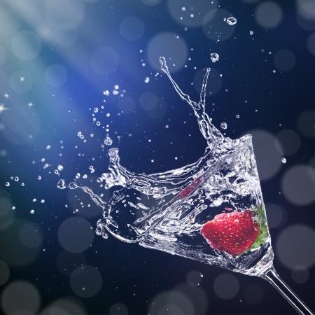 martini splash: Martini drink splashing out of glass
