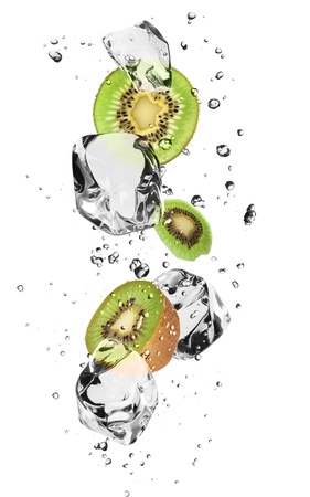 Kiwi slices with ice cubes, isolated on white background photo