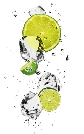 Limes with ice cubes, isolated on white background Stock Photo