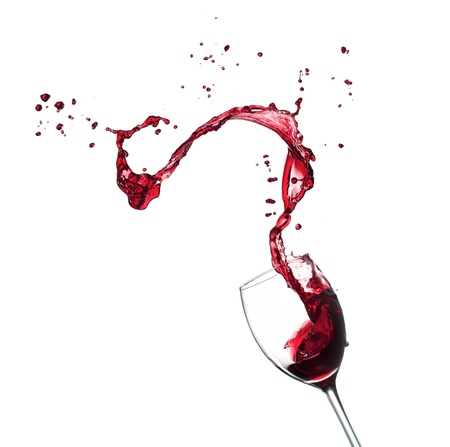 pour: Red wine splashing from glass, isolated on white background Stock Photo