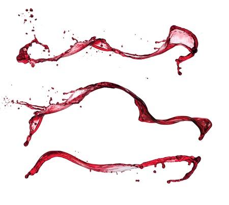 splashed: Red wine splashes isolated on white background